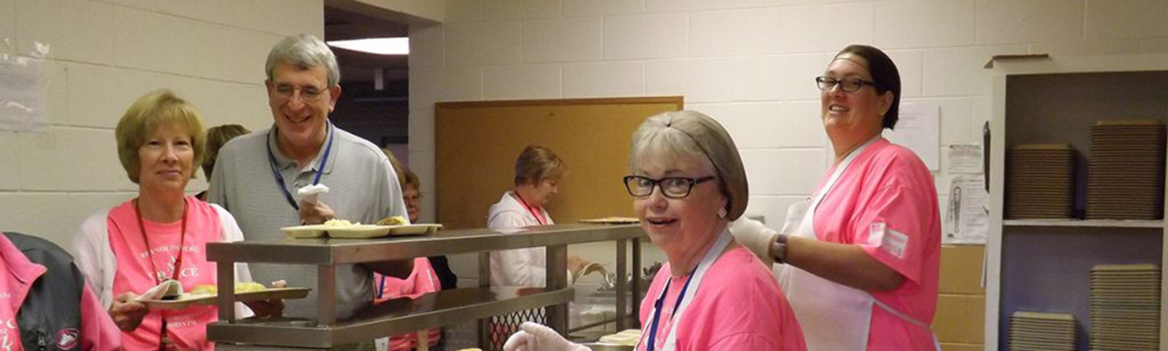 Volunteers serving at the cafeteria