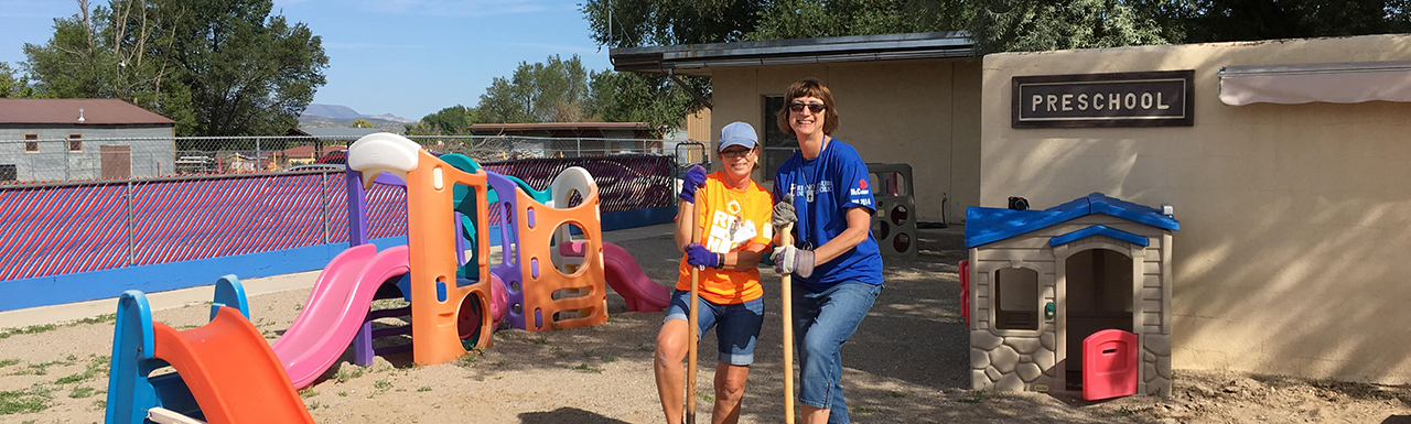 Volunteers working on the preschool playground